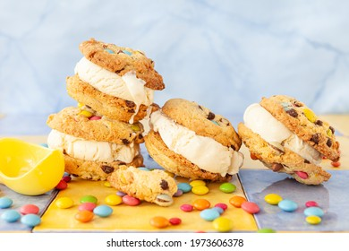 Vanilla ice cream sandwich with chocolate chip cookies and colorful chocolate lentils