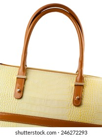 Vanilla leather handbag with brown handles isolated on white.