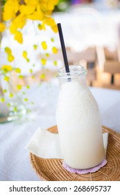Vanilla milk shake in a glass bottle