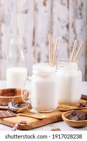 Vanilla milkshake served with chocolate over white texture background