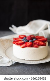 Vanilla  mousse cake with fresh berries copy space