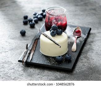 Vanilla panna cotta with black berries.