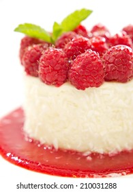 Vanilla panna cotta with raspberries. Selective focus. on white background