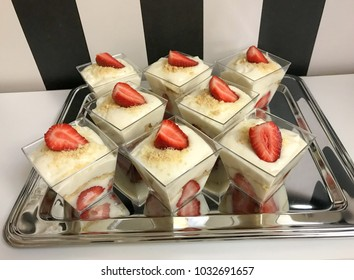 vanilla pudings with strawberry and biscuit.