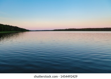 Vanilla sky over calm lake