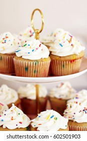 Vanilla Sprinkle Cupcakes on Vintage Tiered Cupcake Stand