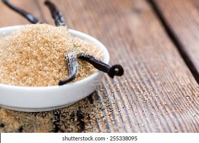 Vanilla Sugar (Brown) on wooden background (close-up shot)