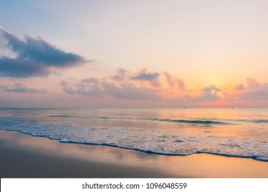 vanilla twilight sky over the beach with soft white sand in early morning. Summer sky on silver sea at beautiful famous beach - Thung Wua Laen Beach, Chumphon, Thailand