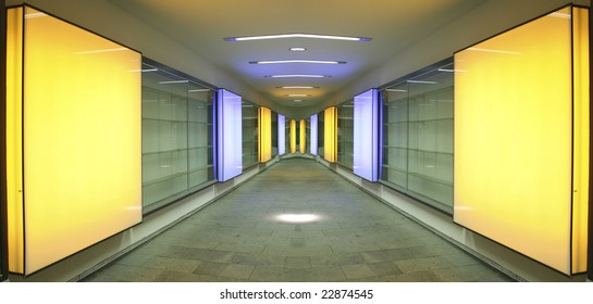 vanishing perspective of alleyway with square orange lights