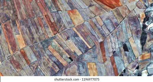 vanishing point, tribute to Picasso, abstract photography of the Spain fields from the air, aerial view, representation of human labor camps, abstract, cubism, abstract naturalism,