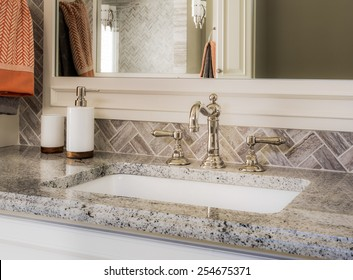 Vanity with Sink, Faucet, Mirror in luxury home