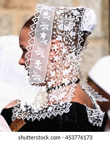 VANNES, FRANCE - AUGUST 15, 2012: Woman wearing traditional breton embroidered lace headdress participates celtic festival in Vannes, french Brittany on the 15th August 2012.