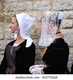 VANNES, FRANCE - AUGUST 15, 2012: Two women wearing traditional breton embroidered lace headdress participate in celtic festival in Vannes, french Brittany on the 15th August 2012.