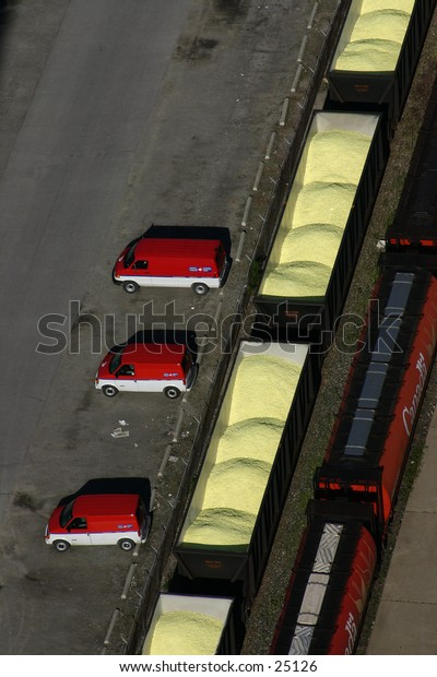 Vans and freight train from above.