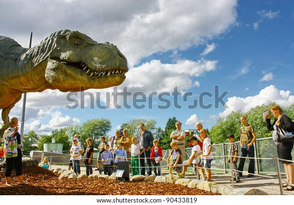 VANTAA, FINLAND - APRIL 22: People look at Dinosaur exhibition in Finnish Science Centre Heureka on April 22, 2011 in Vantaa. Designed and produced by Rafael Estevez with Mexican Museo del Desierto.