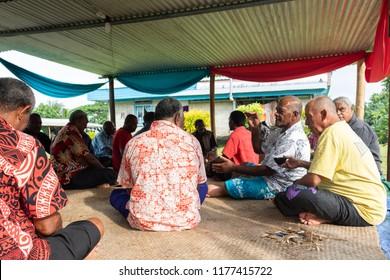 Vanua Levu, Fiji - February 10, 2017 - Group of Fijian Men Drinking Traditional Kava in Celebration in Fiji