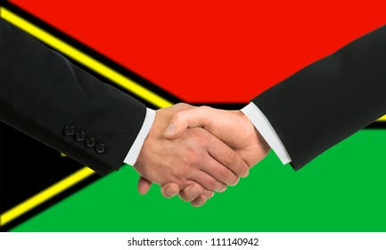 The Vanuatu flag and business handshake