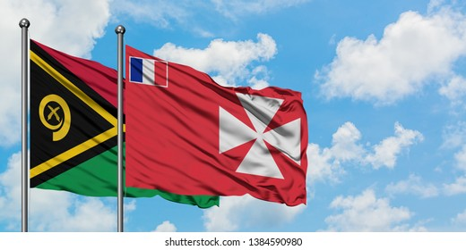 Vanuatu and Wallis And Futuna flag waving in the wind against white cloudy blue sky together. Diplomacy concept, international relations.