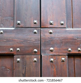 vanzaghello abstract  rusty brass brown knocker in a  door curch  closed wood lombardy italy  varese