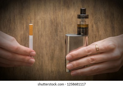 vape and cigarettes holding a girl in her arms