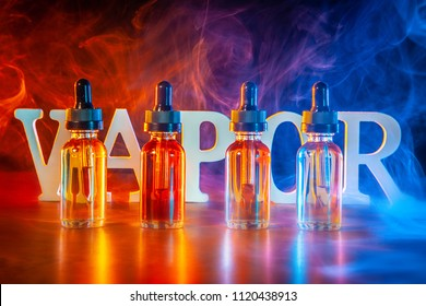 VAPE Electronic Cigarette. Liquid for VAPE. Steam from an electronic cigarette. VAPE concept