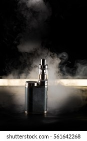 vape, electronic cigarette, on a black background with backlighting and smoke, addiction and harm to health