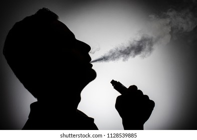 vape man silhouette person vaping electronic cigarette, e cig drug inhalant