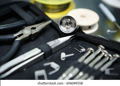 Vape shop upgrade parts in close up.Buy popular electronic cigarette for smoking ejuice.Screwdrivers tool kit & dripper head