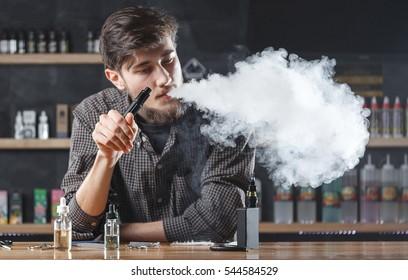 Vape. Vaping man in a cloud of vapor.