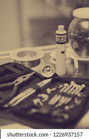 Vaper equipent for smoking eliquid. Vaping device maintenance in vape shop