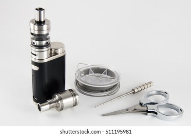 Vaping Devices with Rebuildable Dripping Vaping Atomizer tools. Close up.