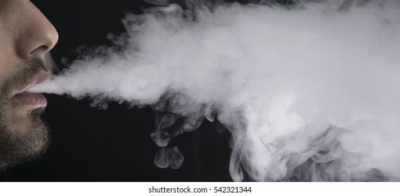 vaping an electronic cigarette with a lot of smoke.