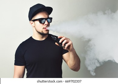 Vaping man. A cloud of vapor. white background.