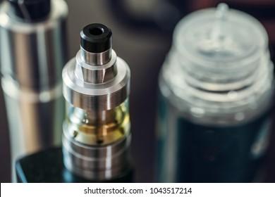 Vaping pen macro shot, vape devices wit e-liquid, electronic cigarette, selective focus