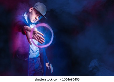 Vaping. Vape trick rings in performance of vaper on red blue background. Vape Rings.