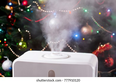 Vapor from humidifier on Christmas background