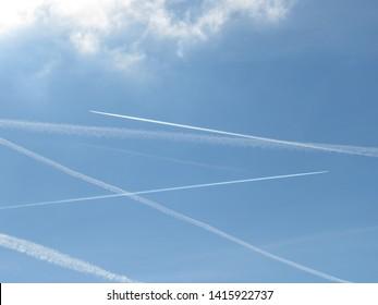 Vapor trails in a blue sky