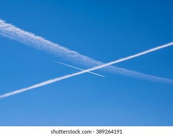 Vapor trails into the blue sky