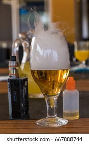 Vaporizer and smoking beer with bottle on table