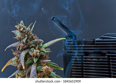 Vaporizing cannabis concept shot. Vaporizer mouth piece and plant bud with a smoke.