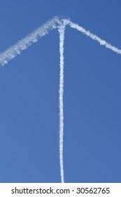 Vapour Trail Arrow on Blue Sky