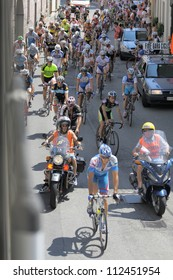 VAPRIO - AUGUST 10: Cyclists at the local Annual Holy Day Bike Race on August 10, 2012 in Vaprio d' Agogna, Italy