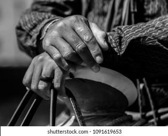Vaquero closeup of hands on saddle horn