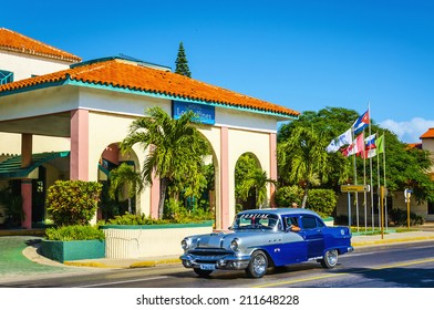 VARADERO, CUBA - DECEMBER 3, 2013:  Classic American car cruising on one of streets in Varadero, where old cars bought before Cuban revolution are icon view of Cuba