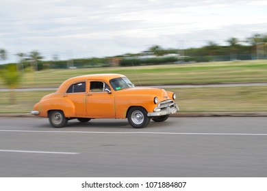 VARADERO, CUBA - January 9, 2018: Vintage classic car rushing on the road.
