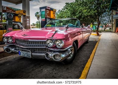 VARADERO, CUBA - JUNE 19, 2015: HDR - Pink Cadillac classic car refuel at the gas station - Serie Cuba Reportage