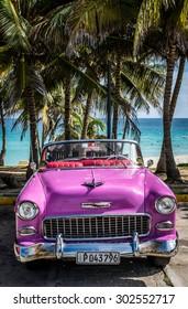 VARADERO, CUBA - JUNE, 22 2015: HDR Pink american classic car on the beach
