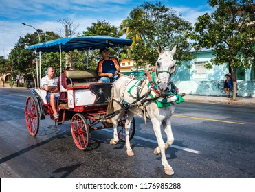 Varadero / Cuba - March 19, 2016: Carriage rides on horse and buggies called Hicacos are a fun way to get around the Cuban beach resort town of Varadero.