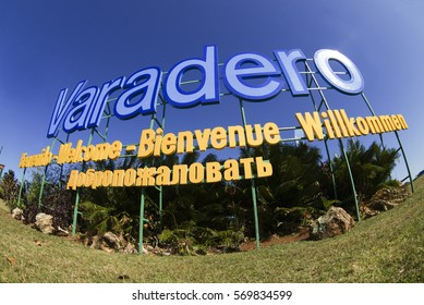 VARADERO, CUBA - OCTOBER 08, 2016: Panoramic view of grand blue and yellow inscription Varadero at the entrance to the city at summer sunny day