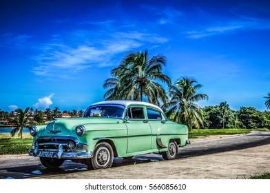 Varadero, Cuba - September 11, 2016: HDR - American green Chevrolet classic car parked near the beach in Varadero Cuba - Serie Cuba Reportage